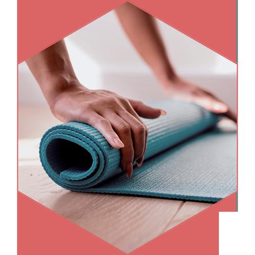 Hands rolling yoga mat