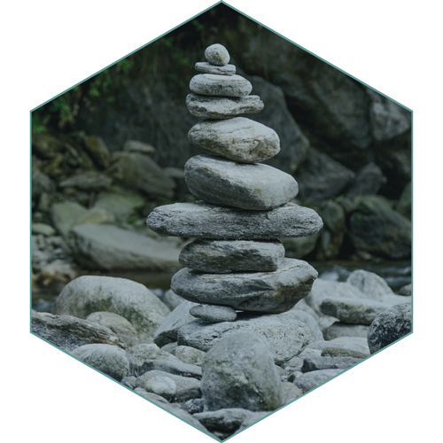 Stack of rocks on riverbank